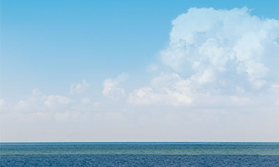 Photo of clouds and water